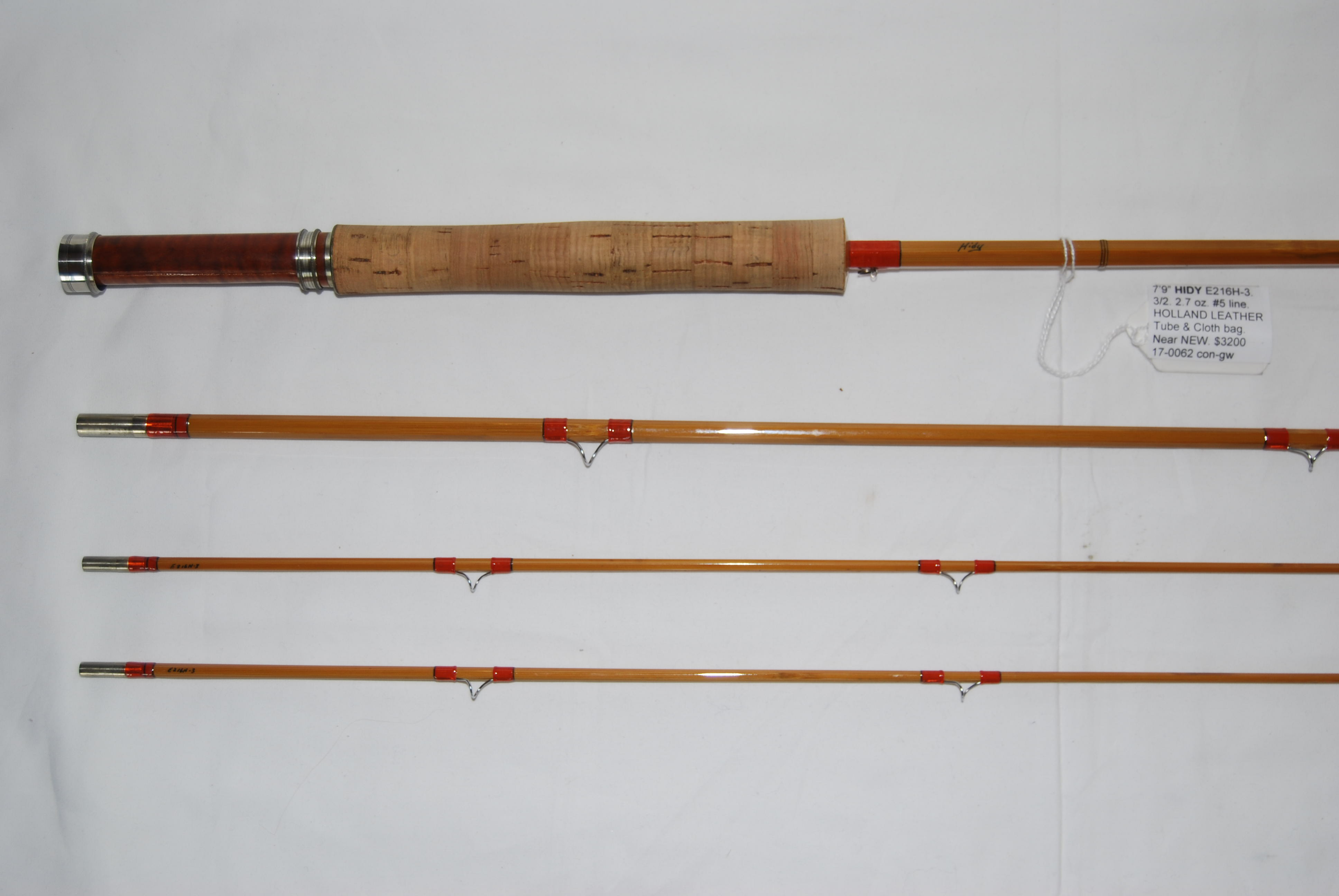 "Image for 7'9"" HIDY E216H-3. Bamboo 3/2. 2.7 oz. No. 5 line. Hollow-built. In cloth bag & HOLLAND SPORT leather rod tube."