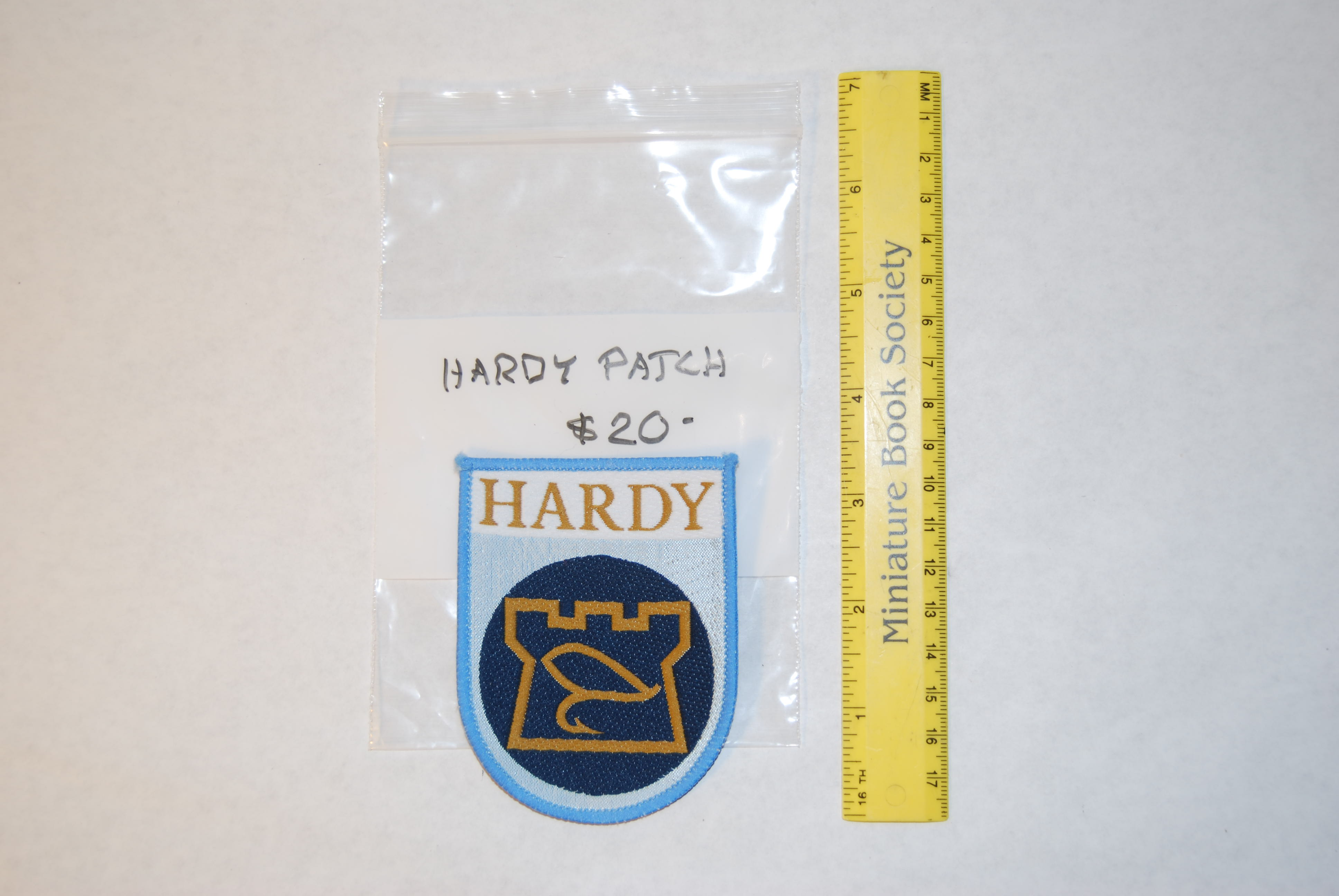 "Image for HARDY JACKET PATCH 3 1/2 in. x 2 1/2  in. Gold ""HARDY"" & Logo on mixed blue background."
