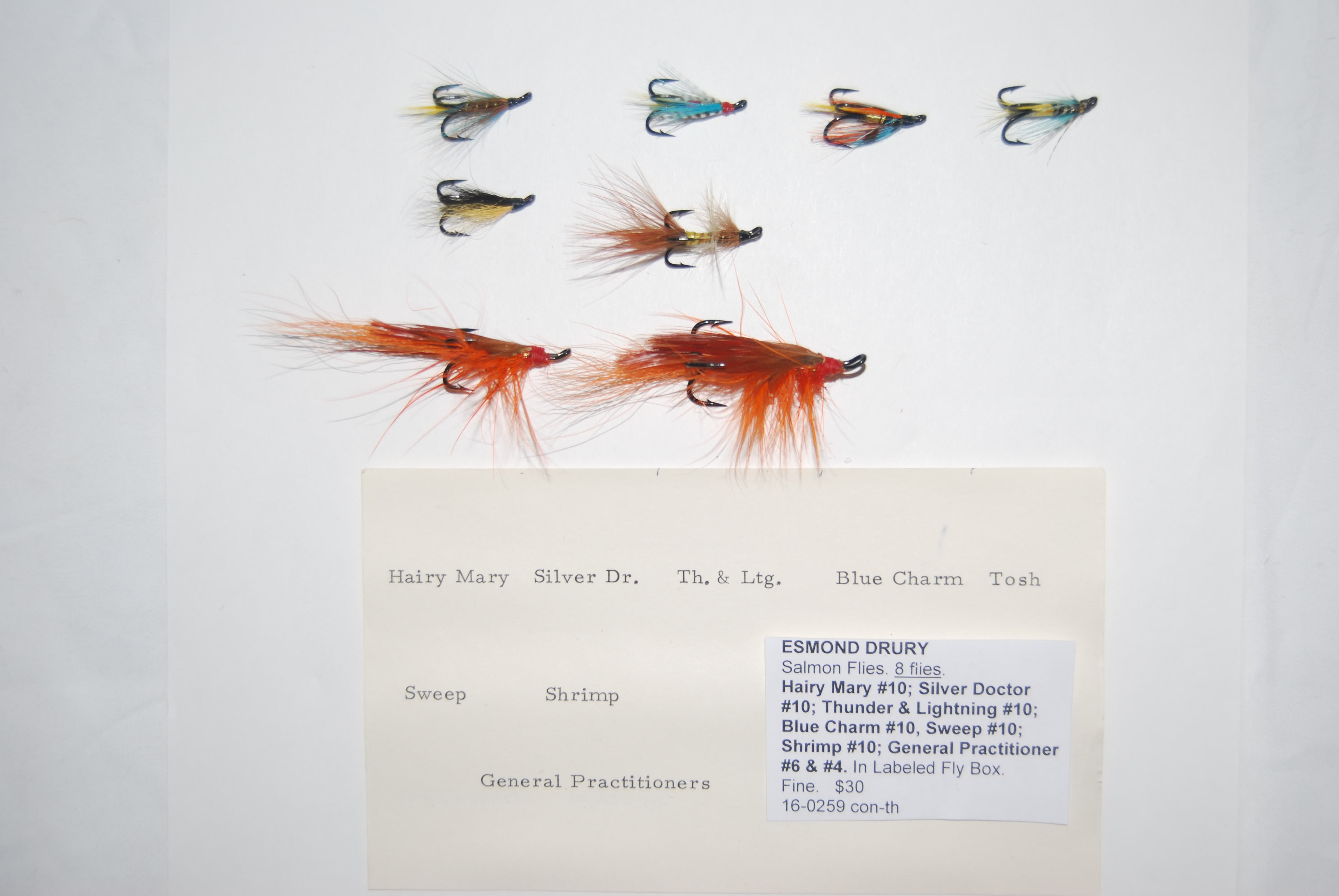 Image for ESMOND DRURY Salmon Flies. 8 Flies, all labeled on Esmond Drury Treble Hooks, in Scientific Angler plastic fly box with following flies: Hairy Mary #10; Silver Doctor #10; Thunder & Lightning #10; Sweep #10; Shrimp #10; General Practitioner #6 & #4. Labels are printed on the base of the Fly Box.