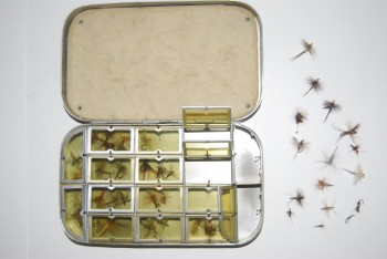 "Image for  6 in. WHEATLEY Bright Aluminum 16-Compartmenrt Fly Box with Sheepskin pad on inside lid. 6"" x 3 1/2"" x 1 1/8""  40+ dry flies in box #12-16. Marked: ""G.M.A. /29-4-35"" professionally engraved on lid."