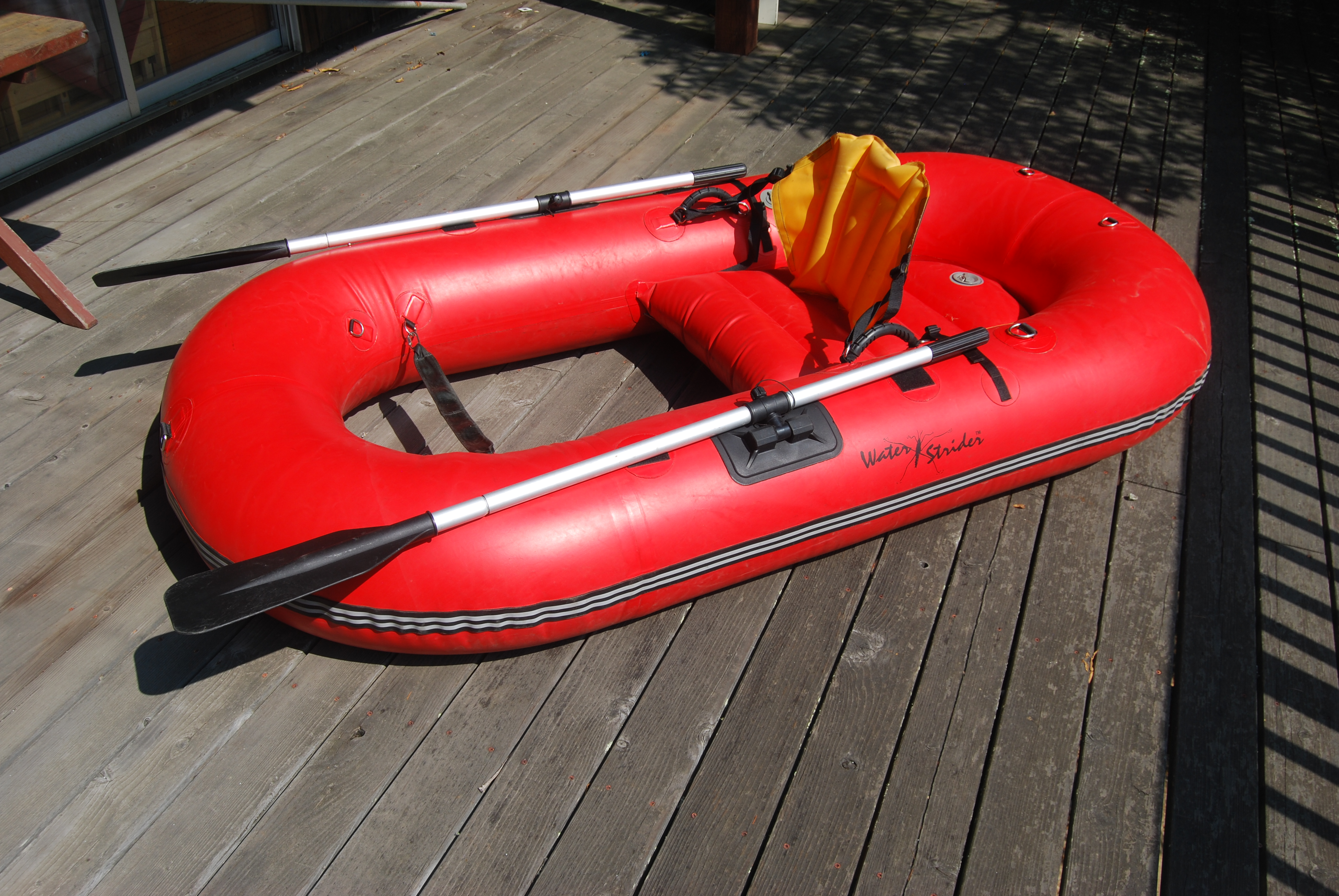 Image for WATER STRIDER RAFT KICKBOAT. Complete with 3-pc. Oars, Inflatable Back Rest, Kickboat Fins, Foot Model Pump, Ruled Stripping Apron, Patch Kit, Backpack to carry Raft, Expedition Bag, Electric Inflator.
