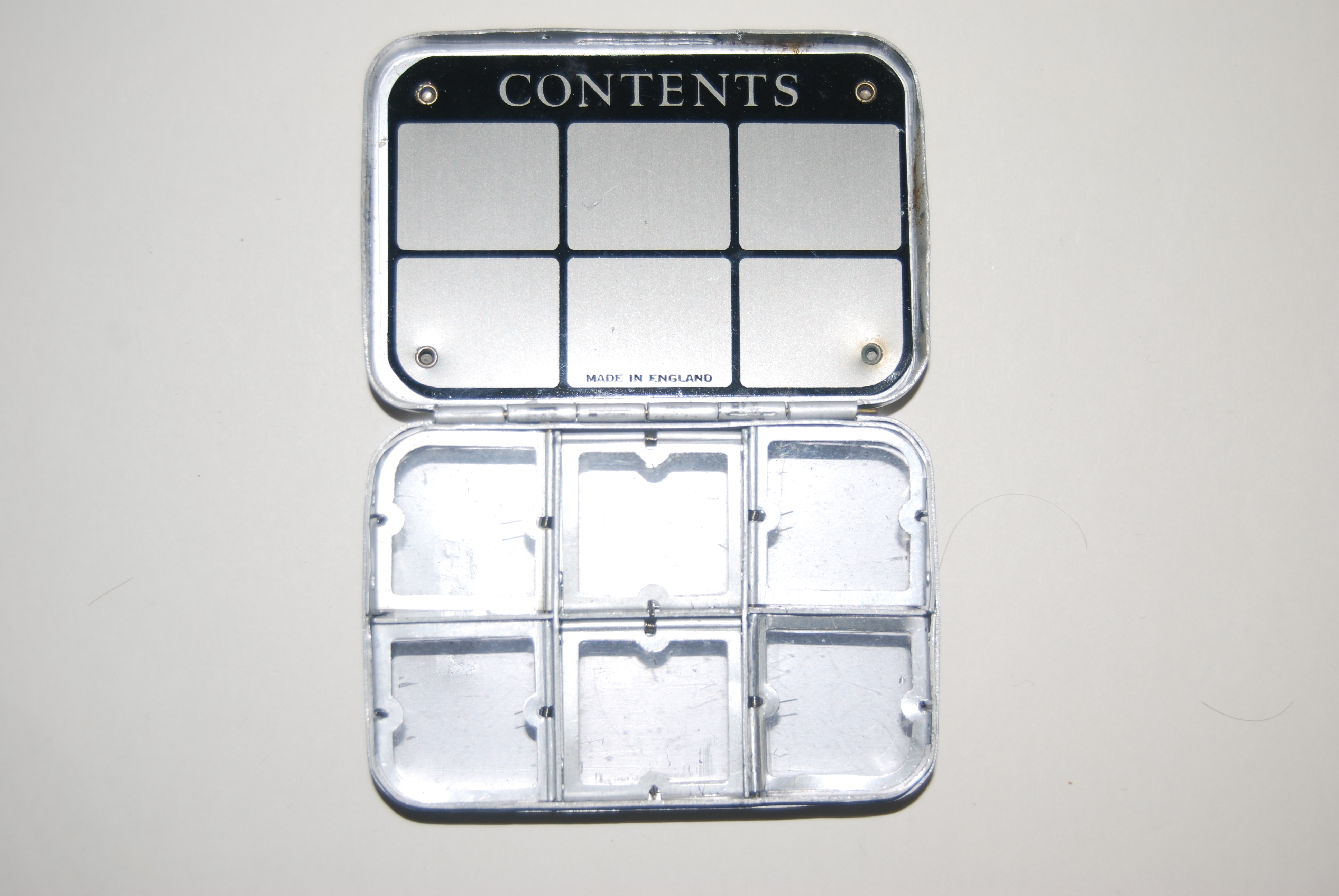 "Image for 3 1/2 in. WHEATLEY 6-Compartment Dry Fly Box with ""Contents"" space inside lid. 3 ½"" x 2 ½"" x ¾"". Silmalloy Metal. 5 of 6 lids work"