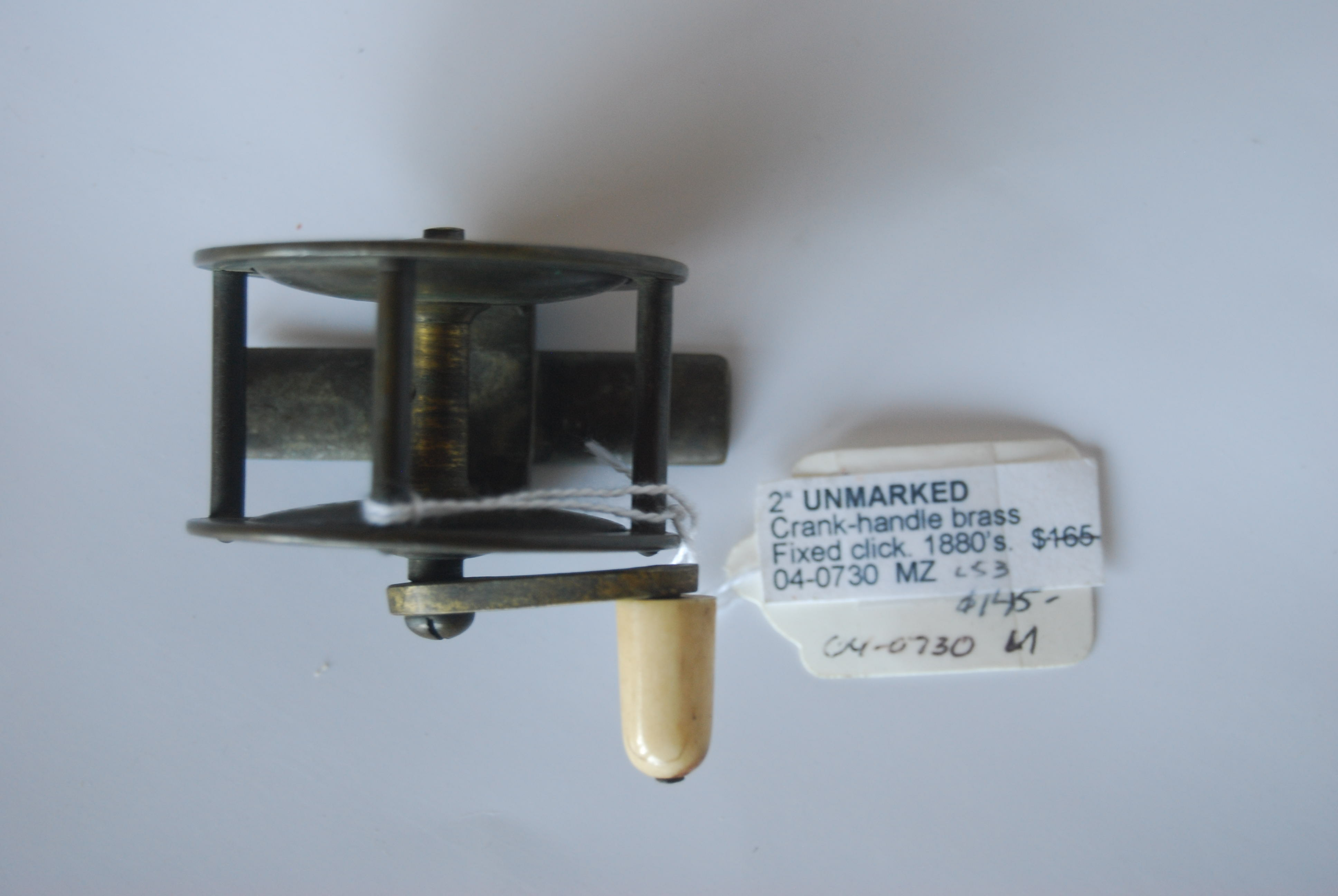 "Image for 2"" UNMARKED Curved crank-handle brass; Ivory  knob;  Fixed click. Circa 1880's. 5 oz."