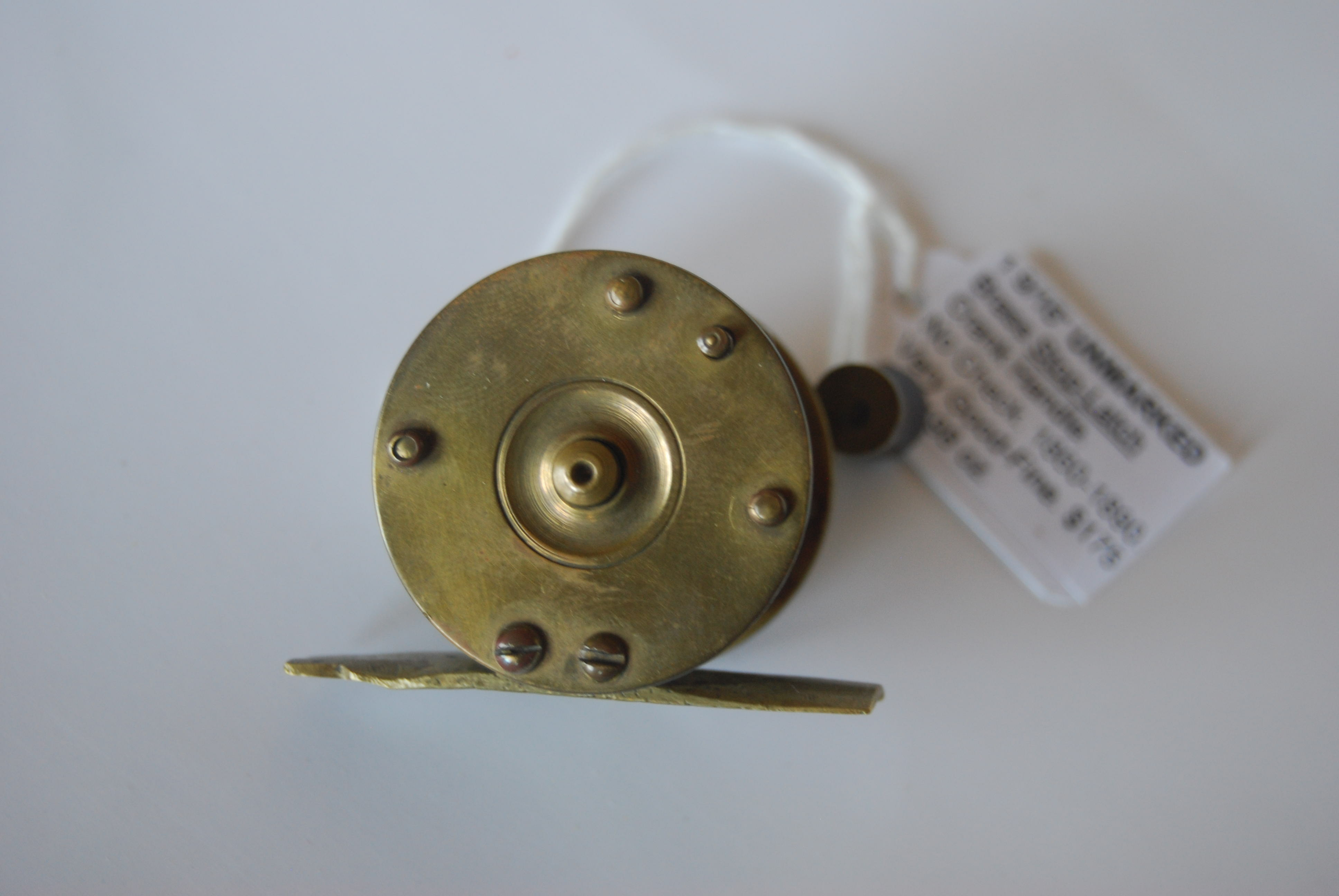 "Image for 1 9/16"" UNMARKED Brass Stop-latch reel. 1 1/4 in. pillars; 3 1/4 oz.  No Check; Wood knob on crank handle; with olive & black braided line. Circa 1850-1890."