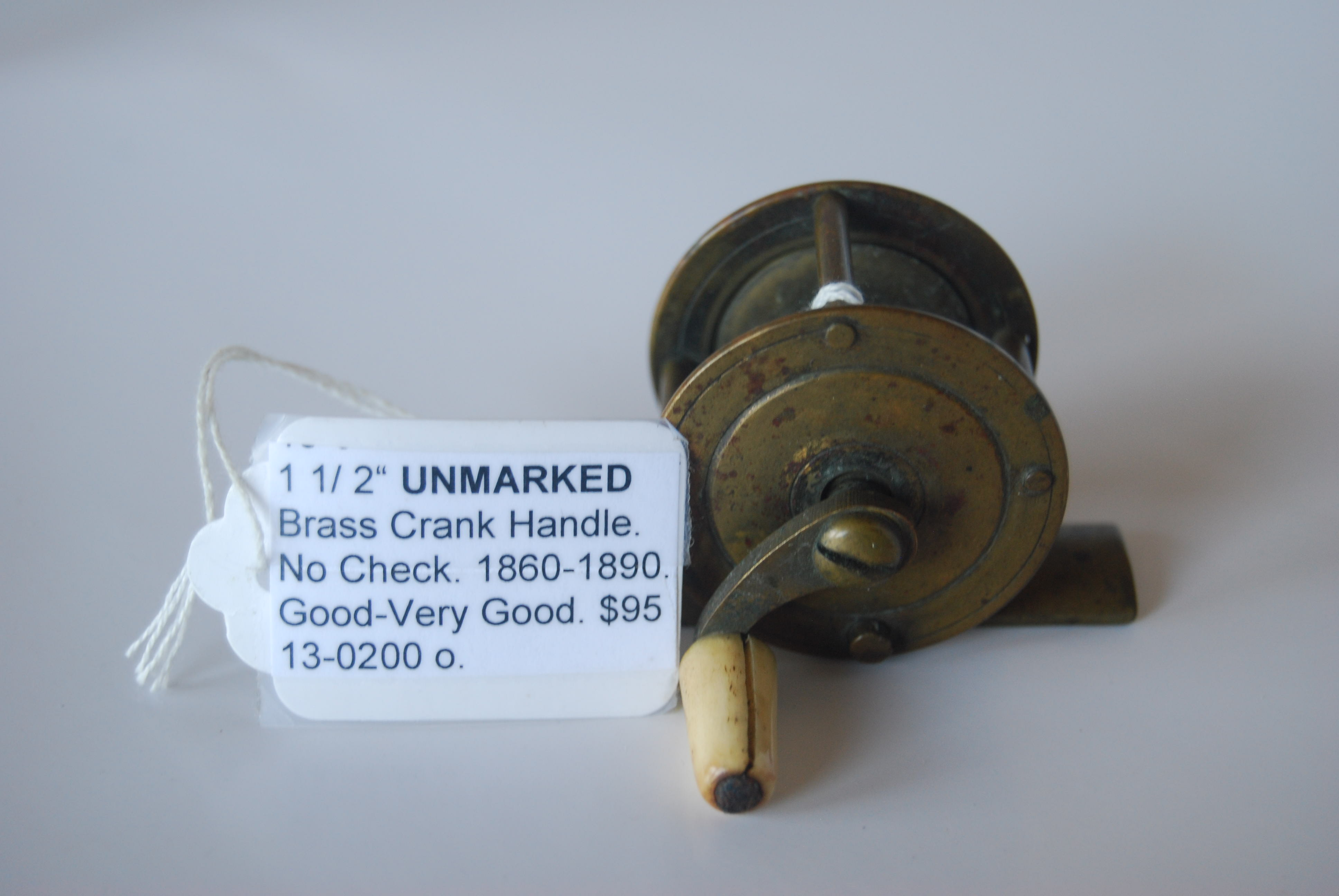"Image for 1 1/2"" UNMARKED Brass Crank-handle reel. 7/8 in. pillars; No Check; White Bone knob on curved crank handle; Circa 1860-1890. 2 3/8 oz."