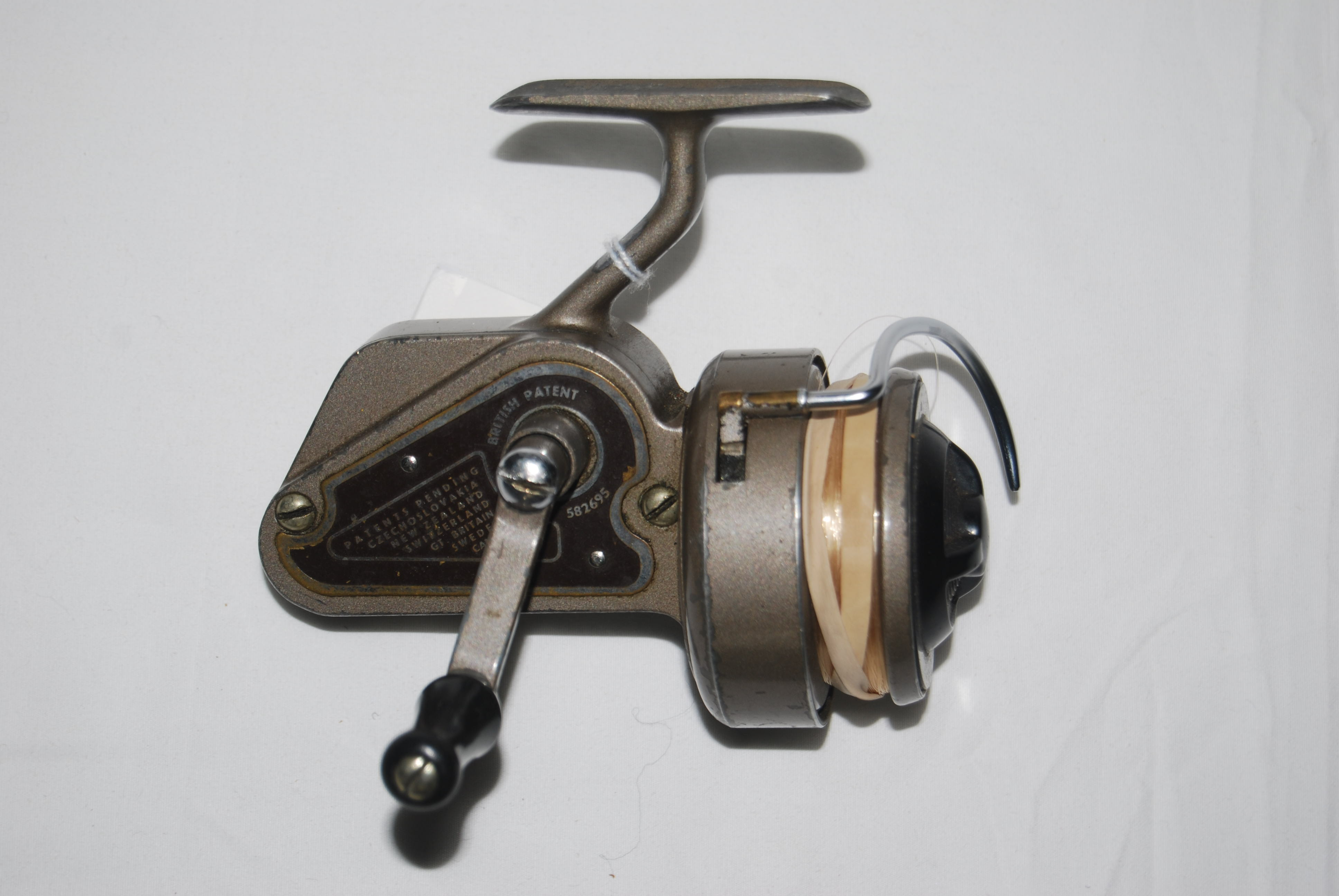 Image for J.W. YOUNG AMBIDEX No. 2 Spin Reel. LH/RH. Circa 1947. First spinning reel to have a reversible handle, for use LH or RH. Half-bail. In cloth bag.