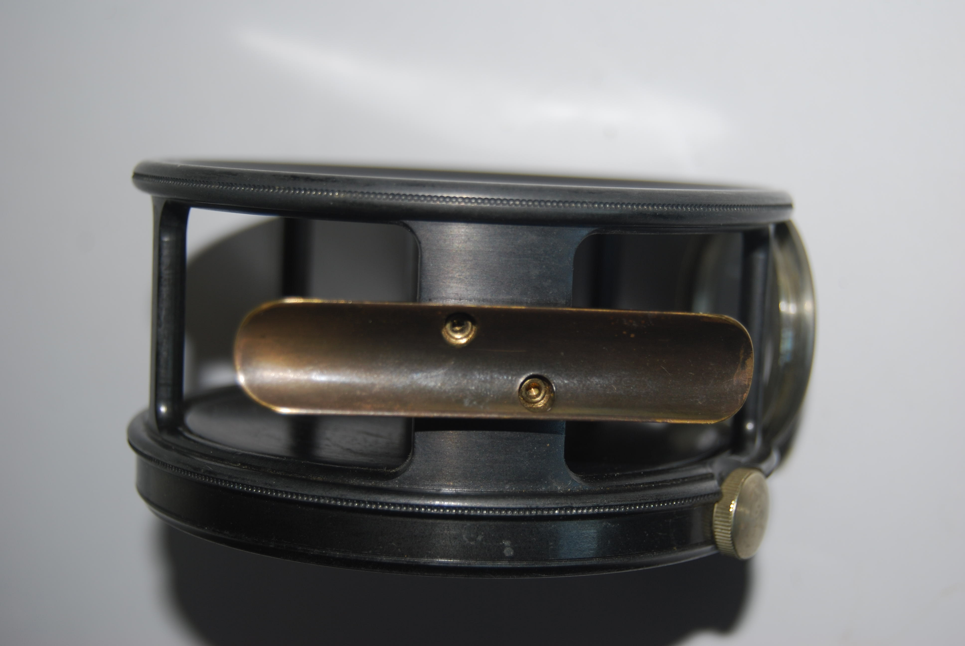 "Image for 4"" HARDY PERFECT SALMON Wide Spool. Circular N/S Line Guard. RHW. Short [ 2 5/8""] Ribbed Brass Foot; Ebonite knob; Straight line writing: Dupl. Mk II Check with spares; Spool retaining screw. 14 3/4 oz. Circa 1956-60.  Will hold 8/9/10 Spey line + backing. Grey enamel finish. In Neoprene Case,"