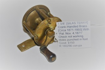 "Image for 1 5/8"" [SILAS TERRY] Crank-Handled Brass Trout Reel. [Circa 1871-1893] 2 5/8 oz.  1 1/16 in. spool width; With Silas Terry patent clearly marked on foot: ""Pat. Nov. 14, 1871."" Wooden knob; 2 3/4 in. smooth brass foot; Check not working."