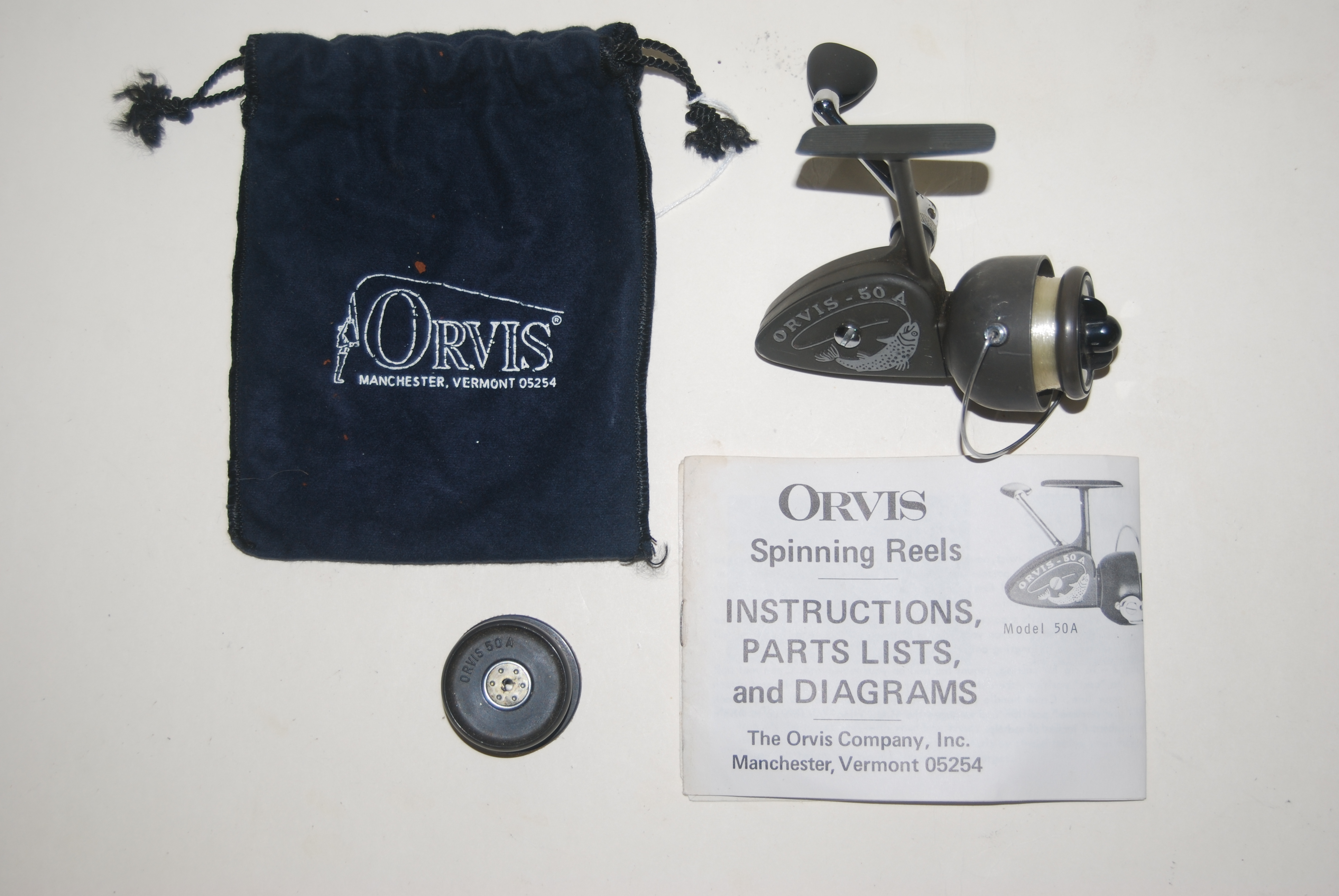 Image for ORVIS 50A ULTRA-LITE SPIN REEL + EXTRA SPOOL + INSTRUCTION SHEET.  6 ½ oz. Extra Fast 5:1 retrieve ratio [22 ¼ in. per turn of handle] Capacity 160 yd. 2# or 130yd. 6#. Circa 1967.